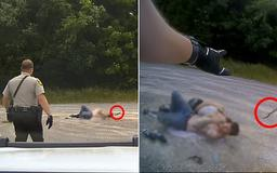 Police officer comes to the rescue of sleeping couple as deadly rattlesnake is filmed slithering right up beside them, just inches from their heads