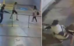 Two 14-year-old boys are arrested after allegedly throwing a woman to the ground, repeatedly stomping on her chest and stealing her handbag