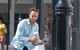 James Middleton has his hands full as he grapples with his dogs on trendy Kings road in Chelsea