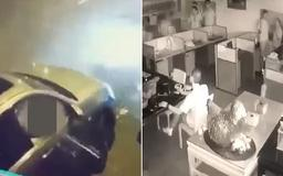 Shocking moment shop workers are kidnapped by gang members armed with AK-47s and grenades before being rescued by police unharmed in Taiwan