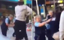 Horrifying moment 14-year-old girl hits a female police officer in the face in a shocking and 'unprovoked' attack at Westfield