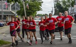 Police officers carry Special Olympics torch