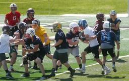 Snap to it: Class B centers, quarterbacks need to learn the other's quirks
