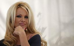 Pamela Anderson wows in sexy swimsuit and stilettos at age 51: 'Still the hottest'
