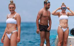 Perrie Edwards PICTURE EXCLUSIVE: Little Mix singer highlights her athletic physique in a white two-piece as she enjoys a spot of snorkelling with shirtless beau Alex Oxlade-Chamberlain in Ibiza