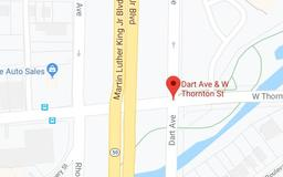 Investigation underway after body found floating in Akron canal