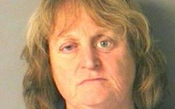 Woman arrested after she pushed her dog in a lake and watched it drown