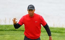 Woods closes on upbeat note, no happy birthday for Mickelson