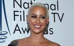 WATCH: Amber Rose Shows Off Her Bare Bump And Reveals Her Difficult Pregnancy