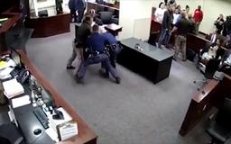 Son of murdered woman tries to attack husband accused of killing her in courtroom