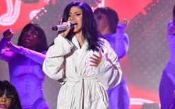 Cardi B's catsuit split during her Bonnaroo performance and she had to finish her set in a bathrobe