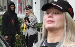 Iggy Azalea steps out make-up free with her rapper beau Playboi Carti as she is seen for the first time since she vanished from social media after nude photo leak