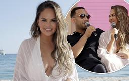 Chrissy Teigen and John Legend admit they have been 'fighting all day' as they put on a loved-up display on stage at Cannes Lions Festival