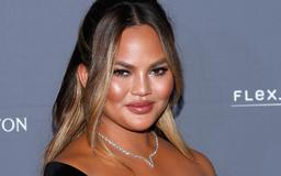 This Photo Of Chrissy Teigen Sitting With Her Legs In The Air Has Fans Asking 1 Question