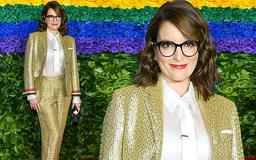 Tina Fey smartens up in gold tweed suit with silky white blouse and tie at the Tony Awards red carpet