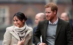 Prince Harry accidentally shared a rare photo of him and Meghan Markle during an appearance at Kensington Palace