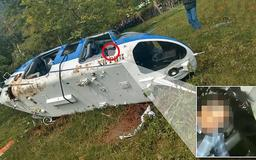 Helicopter 'carrying member of Mexico's most powerful cartel' crashes and leaves the pilot dead and three women injured as gunmen open fire on first responders