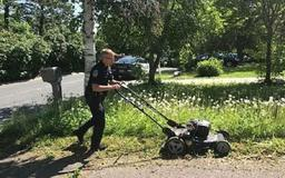 Instead of Ticketing Elderly Woman for Tall Grass, This Cop Mowed it For Her