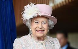 Queen Elizabeth Stuns In All-Pink, Hugged By Polo Player In Awkward Moment