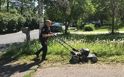 Police officer mows elderly woman's lawn after noticing it is overgrown