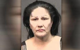 Woman attempts to stab 14-year-old boy, injures his father instead, police say
