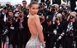 Bella Hadid apologises after backlash over airport snap