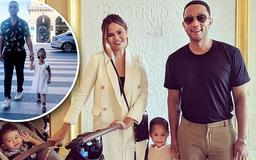 Chrissy Teigen and John Legend strike a pose with their two kids for sweet family snap during their vacation in Paris