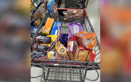Police officer gives young boy walking alone ride home, buys groceries for his family