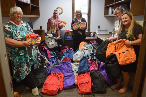 Keller Williams Lake of the Ozarks Realty Donates 400 Backpacks To Local Schools