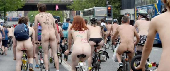 """""""Bare as you dare"""" in clothing-optional Naked Bike Ride Run"""