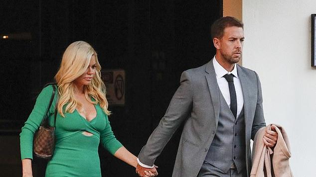 Picture for Sophie Monk sizzles in a plunging emerald pencil dress as she and fiancé Joshua Gross arrive hand in hand for a date night in Melbourne