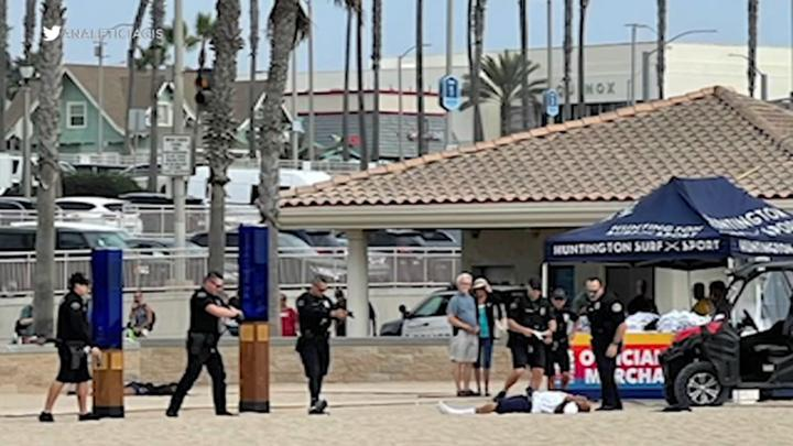 Cover for Huntington Beach police shoot, kill man as US Open of Surfing underway nearby