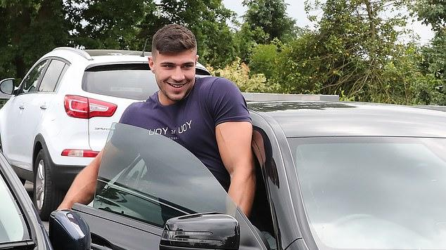 Picture for Love Island's Tommy Fury squeezes into his swanky black Mercedes following a trip to the shops as he hits the road after passing his driving test