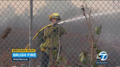 Cover for Wind-whipped brush fire burns 15 acres in Irwindale