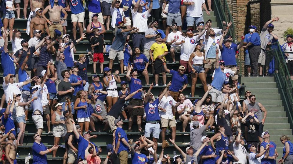 Picture for Incredible Photo of Chicago Cubs Fan On Her Phone, Completely Unaware of Approaching Baseball