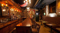 Cover for This Secret Strange Speakeasy Sits Under a Haunted Chicago Famous Bar.