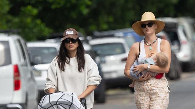 Picture for Gemma Ward looks chic in a retro ensemble as she takes baby daughter Kirra out for a stroll in Byron Bay with her model pal Jessica Gomes in tow