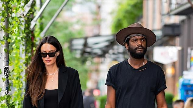 Picture for Nicole Trunfio flaunts her trim pins in a black bodysuit and matching blazer as she steps out with musician husband Gary Clark Jr. in New York