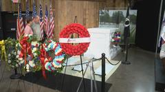 Cover for Tomb of the Unknown Soldier replica in South Dakota sparks veteran reunion