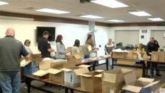 Cover for Scottsbluff Police and Fire Departments pack bags for National Night Out next week