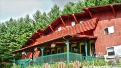 Cover for The 10,000 Square Foot, 10-Bedroom Lodge Near West Virginia's New River Gorge That Sleeps 32