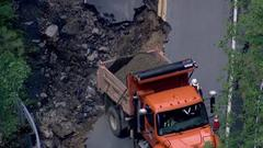 Cover for Aerial video: Significant damage in New Hampshire from flash flooding