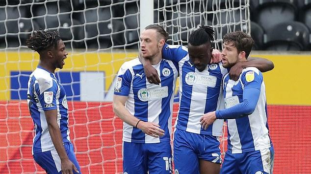 Picture for Wigan's League One survival should go down as a minor MIRACLE after administration shook the club to its core... Leam Richardson held it all together amid a mass exodus and an overnight exit from their training base after it was sold to Preston!
