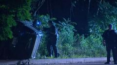 Cover for Crash sends SUV onto side, into woods in Forest Hills