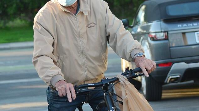 Picture for James Bond actor George Lazenby, 81, swaps fast cars for a push bike as he goes for a cycle in LA