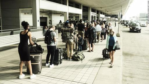Have suitcase, will travel! Americans take to the skies in almost pre-pandemic numbers as Covid-19 restrictions ease