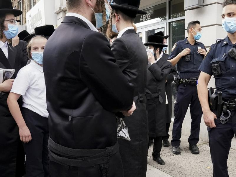 Activist arrested on charges of inciting riot during ...