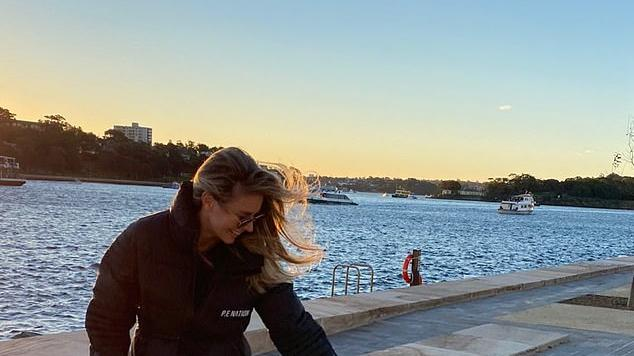 Picture for Jennifer Hawkins dotes on daughter Frankie, one, during a fun day out together with husband Jake Wall