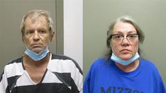 Cover for Missouri couple held as suspects in bank robbery