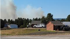 Cover for Wyoming fire crews battling fire near Pine Haven